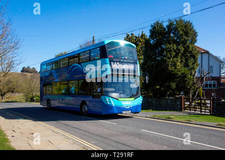 Yorkshire Coastliner bus service from Leeds and York to coastal towns Scarborough Whitby Filey and Bridlington, passing through Goathland on the Moors - Stock Image