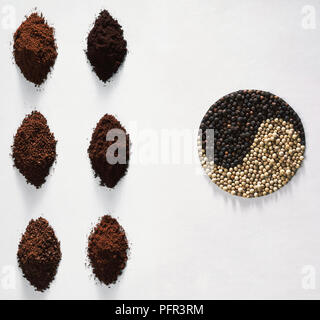 A Range of Coffee Grinds and Peppercorns - Stock Image