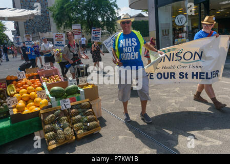 London, UK. 7th July 2018. Keep Our St Helier Hospital (KOSHH) campaigners against the closure of acute facilities at Epsom and St Helier Hospitals in south London celebrate the 70th Birthday of the NHS by marching from Manor Park through Sutton High St to a rally in front of St Helier Hospital.  The closures are prompted by government cuts which call for huge savings by the trust, and would Credit: Peter Marshall/Alamy Live News - Stock Image