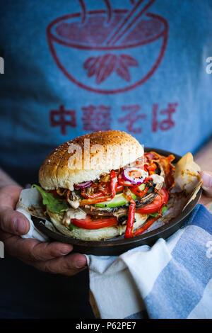 Delicious grilled portobello mushroom burger - Stock Image