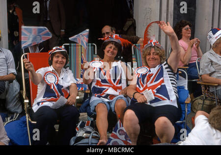 Women outside seated in deck chairs on the Strand during London celebration of Princess Diana and Prince Charles wedding - Stock Image