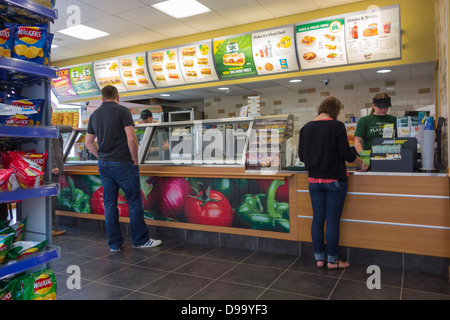 Customers and staff at a Subway sandwich franchise store - Stock Image
