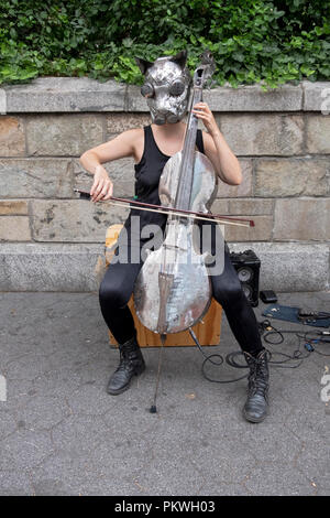 A member of Ensamble Ferroelectrico de Marte from Argentina plays an unusual instrument in Union Square Park in Manhattan, New York. - Stock Image