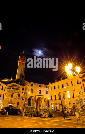 Tower and small square in the city at night - Stock Image