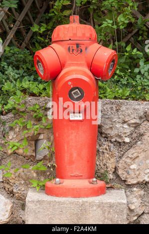 Prominent Red Fire Hydrant in Roquebrune-Cap-Martin in France - Stock Image