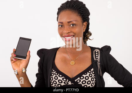 Portrait of smiling young woman showing a mobile phone isolated on white background. - Stock Image