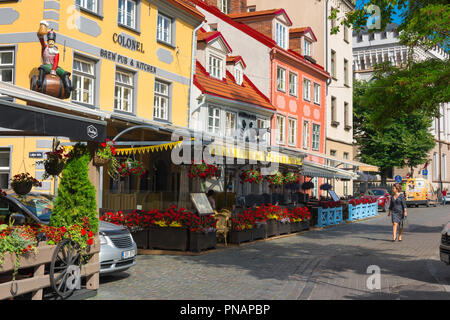 Riga Old Town, view on a summer morning of colorful restaurants and bars facing Livu Laukums square in the historic Old Town area of Riga, Latvia. - Stock Image
