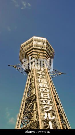 Osaka, Japan - 2010: Bottom up view of Tsutenkaku Tower - Stock Image
