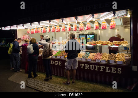 Southsea, UK. 23rd Aug, 2014. Victorious Festival: Late in the evening festival goers tuck into candy floss and - Stock Image