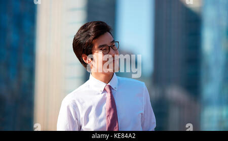 Portrait of smiling businessman outdoors during daytime - Stock Image
