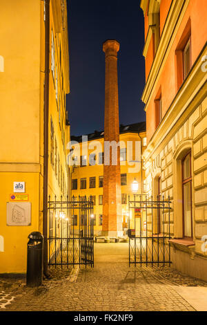 Brick column, visible in a courtyard between buildings in Tryckerigatan on the island of Riddarhomen, Gamal Stan, - Stock Image