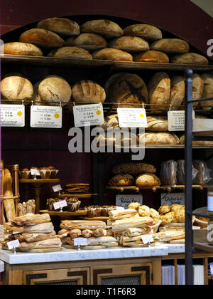 Bread and baguettes for sale in a small independent bakers in Covent Garden, London, UK - Stock Image