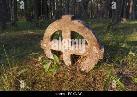 Round crosses in the cemetery of the Vormsi island. Estonia. - Stock Image