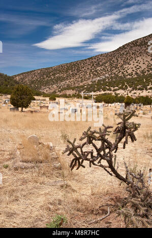Historic cemetery at semi-ghost town of White Oaks in Jicarilla Mountains near Carrizozo, New Mexico, USA - Stock Image