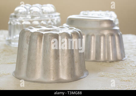 Old fashioned aluminum jelly or blancmange moulds for making traditional jellies - Stock Image