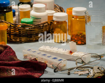 multi-day pill organizers with bottled prescriptions - Stock Image