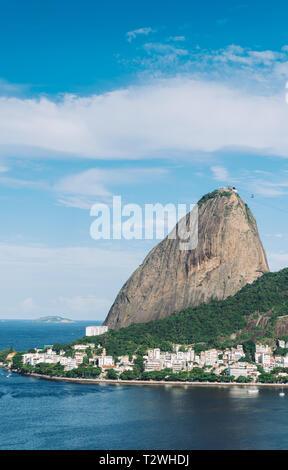 Vertical view of Pao de Acucar rock with the neighbourhood of Urca in Rio de Janeiro, Brazil - Stock Image