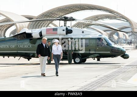 Panama City, Florida, USA. 15th Oct 2018. U.S President Donald Trump and First Lady Melania Trump walk from Marine One to Air Force One at Eglin Air Force Base on their way to Warner Robins Air Force Base after viewing the aftermath of Hurricane Michael October 15, 2018 in Valparaiso, Florida. Credit: Planetpix/Alamy Live News - Stock Image