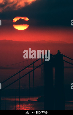 Golden Gate Bridge & Bay Bridge at sunrise - Stock Image