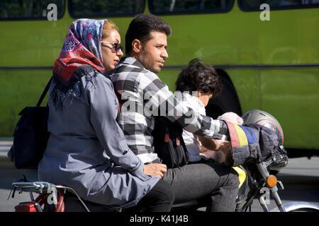 Iranian family travelling on a motorbike, Shiraz, Iran - Stock Image