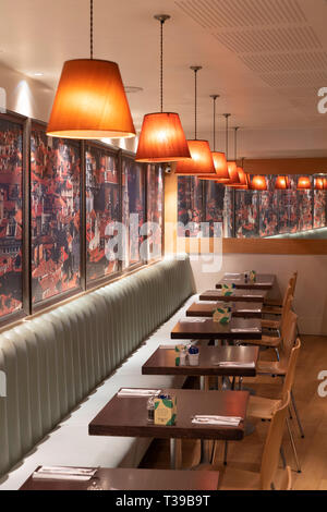 Empty set tables and light shades reflecting in a mirror at Carluccio's in Stratford upon Avon - Stock Image