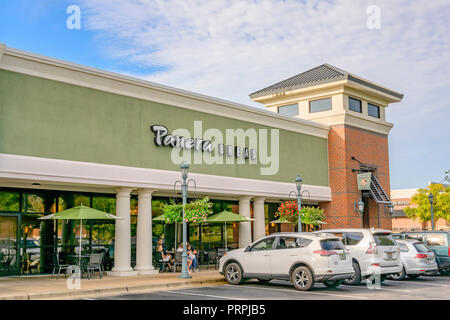 Panera Bread family restaurant front exterior entrance of the chain restaurant showing the corporate sign and logo in Montgomery, Alabama USA. - Stock Image