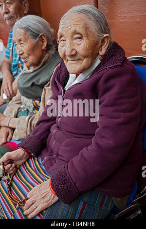 Posed portrait of an older Asian woman at a Himalayan music concert  at the Sherpa Buddhist temple in Queens , New York City. - Stock Image