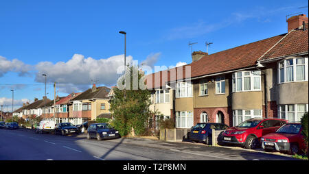 Street of terraced and semi-detached suburban houses in Filton, suburb of Bristol in South Gloucestershire, England, UK - Stock Image