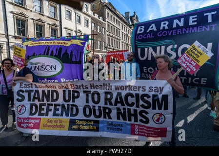 London, UK. 13th October 2018.   Unison and health workers banners at the rally in London to oppose racism  and fascism close to where the racist, Islamophobic DFLA were ending their march on Whitehall bringing together various groups to stand in solidarity with the communities the DFLA attacks. The event was organised by Stand Up To Racism and Unite Against Fascism. Peter Marshall/Alamy Live News - Stock Image