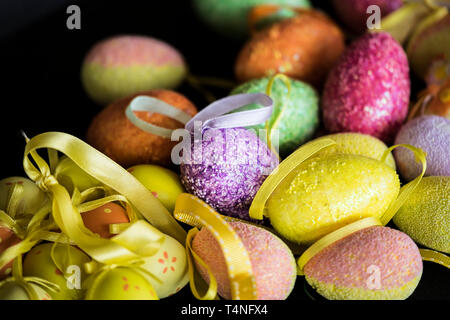 Colourful ornamental and decorative Easter eggs with ribbons for hanging as decorations. - Stock Image