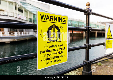 Car clamping sign warning sign vehicle will be clamped no parking zone restriction threat UK England - Stock Image