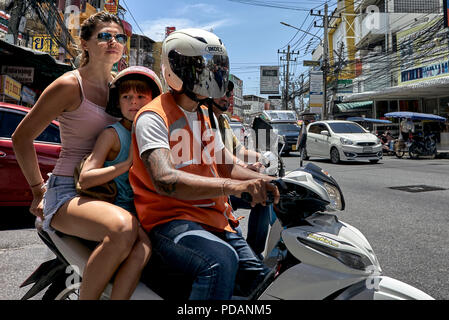 Thailand motorcycle taxi with mother and child passengers, Southeast Asia - Stock Image