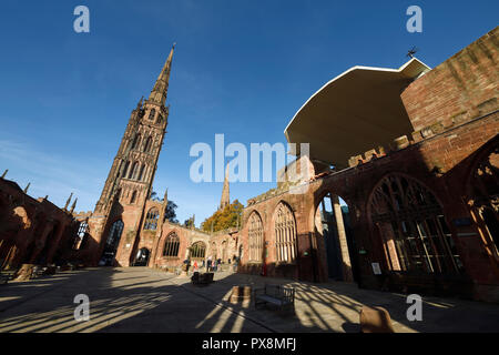 St Michaels Tower and the ruins of Coventry Cathedral adjacent to the New Cathedral on Priory Street in Coventry city centre UK - Stock Image