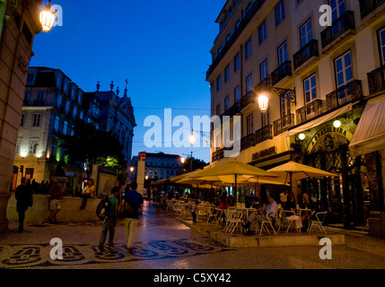 Dusk falls over Café Brasileira in Rua Garrett, in Lisbon's Chiado district. - Stock Image