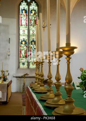 Candles on an altar in a Cathedral - Stock Image