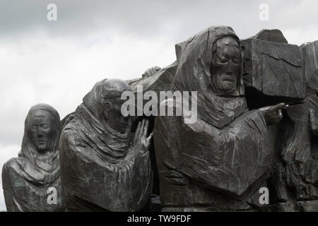 Monks carrying Cuthbert's coffin depicted in The journey sculpture by Fenwick Lawson, Millennium Place, Durham City, England, UK - Stock Image