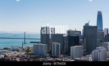 Downtown financial district skyline and partial section of Oakland Bay bridge, views from Coit Tower, San Francisco - Stock Image