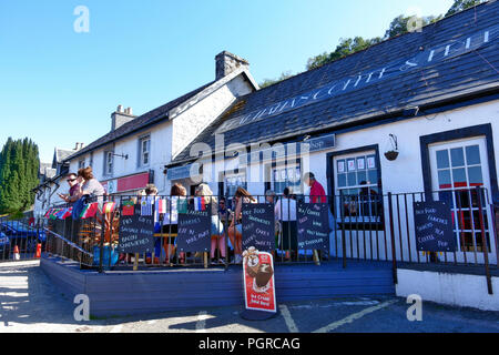 Busy outdoor seating area on a sunny day in the Coffee & Bar  which is popular with ferry travellers at Craignure, Isle of Mull - Stock Image