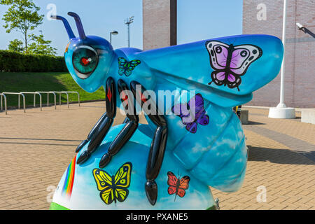 Bee-longing, by Neequaye.  One of the Bee in the City sculptures, National Squash Centre, Etihad Campus, Manchester, UK. - Stock Image