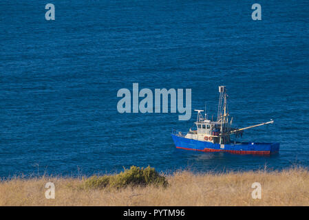 Cray boat anchored off Cape Willoughby on Kangaroo Island in South Australia, Australia. - Stock Image