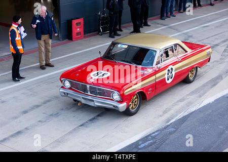 Aerial view of a Red, 1964, Ford Falcon, Touring Car,  in the International Pit Lane,  during the 2019 Silverstone Classic Media Day - Stock Image