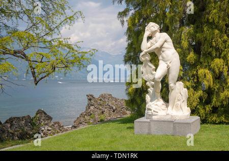 BELAGGIO, ITALY - MAY 10, 2015: The statue of Apollo in gardens of Villa Melzi by G. Della Porta from 16. cent. - Stock Image