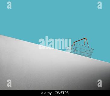 Empty shopping basket on a blue background - Stock Image
