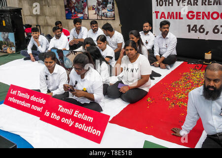 London, UK. 12th May 2019. Tamils begin a hunger strike at Downing St ending on May 18th, Tamil Genocide Remembrance Day, banned in Sri Lanka where it is celebrated as Victory Day by the government. Tamils claim there were 156,689 Tamil civilians unaccounted for at the end of the war, many of them killed by shelling in the last 5 months and no one has been held accountable. They demand recognition of the Tamil Genocide, an International Tribunal to investigate the atrocities and self determination for Tamils in Sri Lanka. Peter Marshall/Alamy Live News - Stock Image