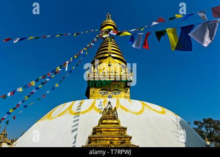 Gilded spire on which are painted the Buddha's eyes, Swayambhunath Stupa or Monkey Temple, Kathmandu, Nepal - Stock Image