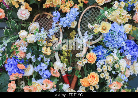 Wimbledon London, UK. 18th June, 2019. A shop in Wimbledon High Street decorated with tennis rackets and flowers ahead of the Wimbledon tennis championships which start on 1 July 2019 Credit: amer ghazzal/Alamy Live News - Stock Image