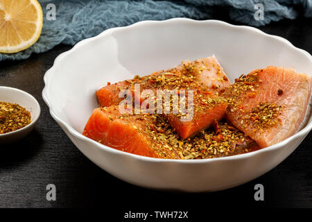 On the table soit dish with red trout fillet - Stock Image