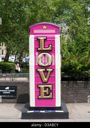 Long Live Love Life telephone box by Ryan Callanan in london - Stock Image