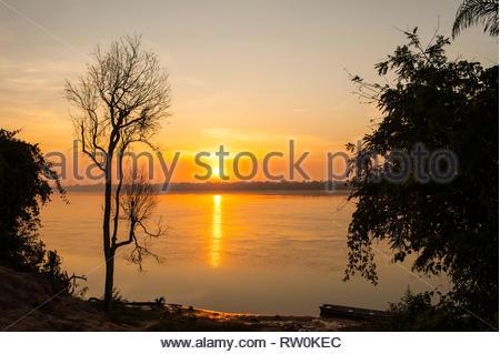 Mato Grosso State, Brazil. Sunrise over the Xingu River. Metuktire village. - Stock Image