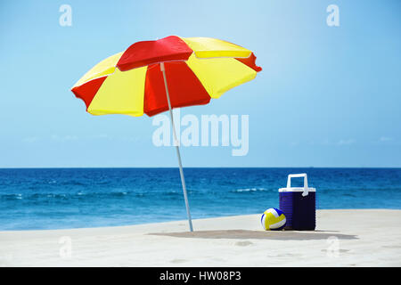 Empty beach with umbrella sea accesorries - Stock Image